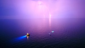 An impressive storm forms a backdrop to coral reef restoration project.